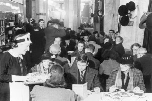 Customers_enjoying_afternoon_tea_at_Lyon's_Corner_House_on_Coventry_Street,_London,_1942._D6573